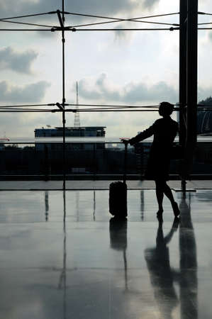 silhouette of flight attendant at the airport
