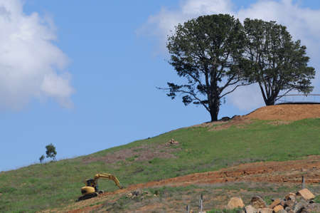Backhoe construction truck on the hill photo
