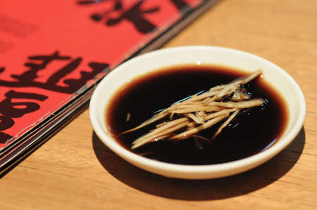 Black Chinese vinegar dipping sauce for Shanghai mini bun 写真素材