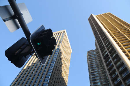 High-rise towers with traffic light photo