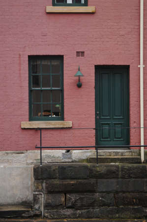 Pinky cherry colour brick townhouse in London photo