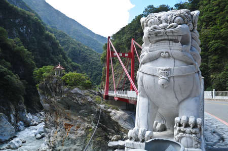 Marble Chinese lion statue at Taroko Gorge Taiwan Stock Photo