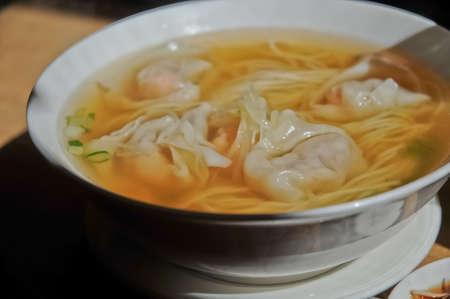 Prawn won ton dumplings noodle soup Cantonese style photo