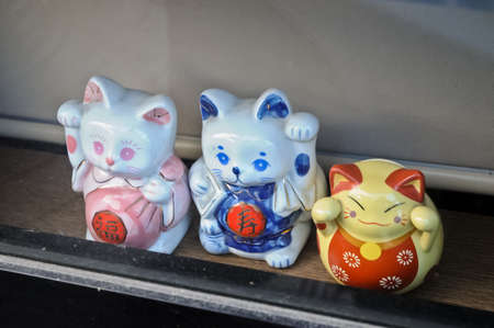 Japanese money kitty ceramic dolls photo