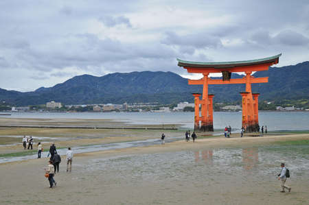 recite: Miyajima red sacred gate on the sand in Hiroshima Japan