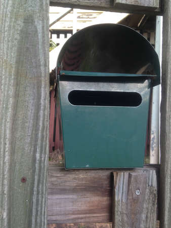 metal post: Green metal post box of a house