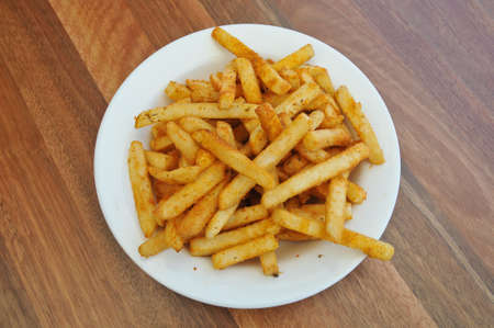 french fries plate: Spice golden french fries on a plate