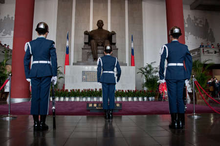 sen: Taipei Taiwan  February 3 2015: Guards are changing at Sun Yat Sen Memorial hall in Taipei Taiwan. This photo is taken in the morning shift inside the central section of the hall.