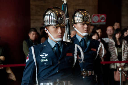 yat sen: Taipei Taiwan  February 3 2015: Guards are changing at Sun Yat Sen Memorial hall in Taipei Taiwan. This photo is taken in the morning shift inside the central section of the hall.