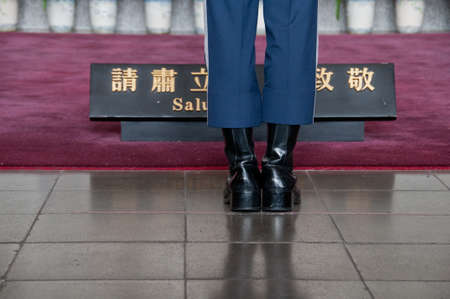 yat sen: Taipei Taiwan  February 3 2015: Guards are changing at Sun Yat Sen Memorial hall in Taipei Taiwan. This photo is taken in the morning shift inside the central section of the hall. Soldier stands at Sun Yat Sen Memorial hall in Taiwan