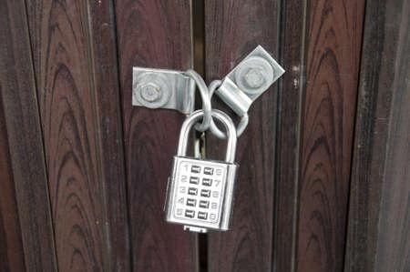 numpad: Wooden door locked by silver numpad
