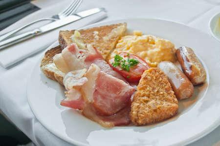 hashbrown: Big breakfast on white plate