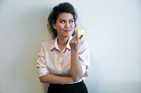 cheddar: Business woman hold cheddar cheese toy model Stock Photo