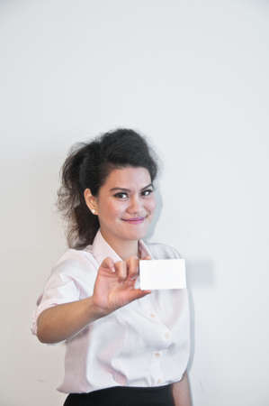 show business: Business woman show white blank card on white backgroud