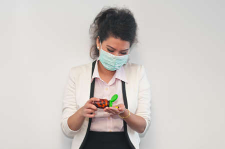 heal sickness: Business woman wear mask cover and take medicine Stock Photo
