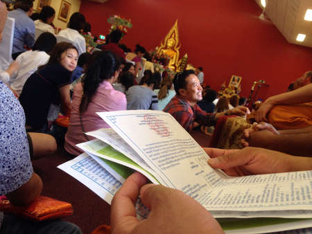 deed: Katin good deed merit event in Thai temple in Brisbane Australia Stock Photo