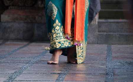 Feet of traditional Bali dancer in Barong performance