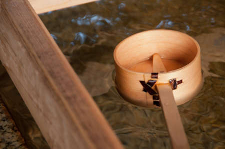 Wooden dipper of holy zen water in Japan Shinto temple