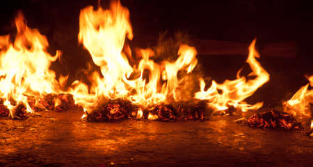 Burning fire stone on a floor background