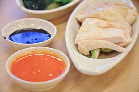 Delicious legendary Singaporean Hainanese chicken rice with two tones dipping sauce 写真素材