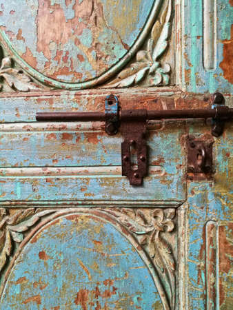Morroccan vintage metal lock key on blue old door Stock Photo
