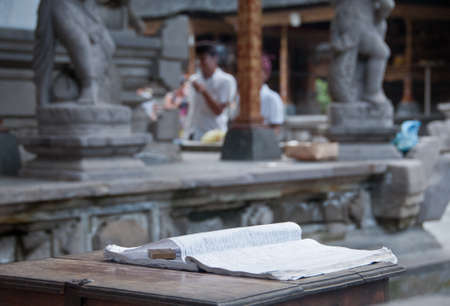 Guest book on wooden table in Bali Hindu temple
