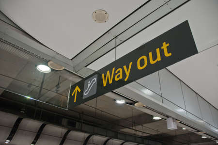 Way out emergency evacuation exit sign arrow direction in the train station Stock Photo