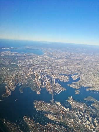Bird eye view aerial scene of Sydney Australia city center from an airplane window