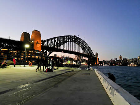 SYDNEY, AUSTRALIA - MAY 5, 2018: Sydney Harbour Bridge, which is a landmark near the famous Sydney Opera House in the evening.