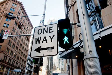 One way traffic sign direction in the city center in Sydney Australia 版權商用圖片