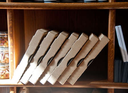 Empty stack of Italian pizza boxes lay in a wooden shelf in a restaurant in sunny day Stock Photo