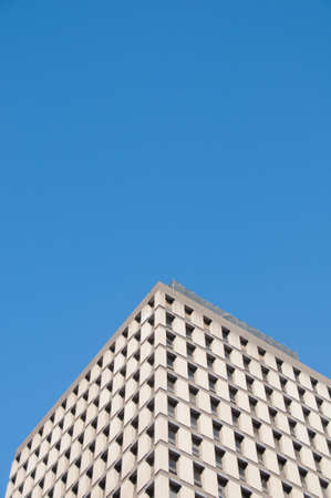 Tall and high classic corporate office building with blue sky and no cloud