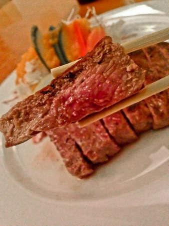 Medium rare premium Kobe beef Japanese steak eat with chopsticks