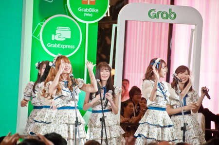 BANGKOK, THAILAND - NOVEMBER 21, 2018: Press conference & Concert event by Grab to annouce members of BNK 48 Thai idol group band to become the Brand Ambassador. There are many people in the event.
