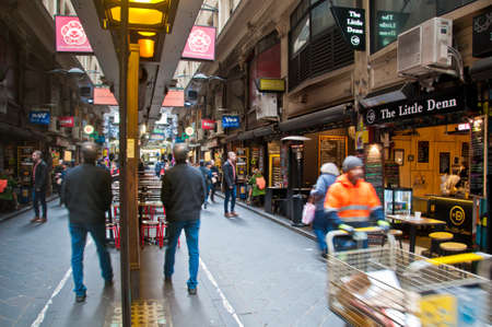 MELBOURNE, AUSTRALIA - JULY 26, 2018: People walk in cozy Degraves lane in morning in Melbourne Australia