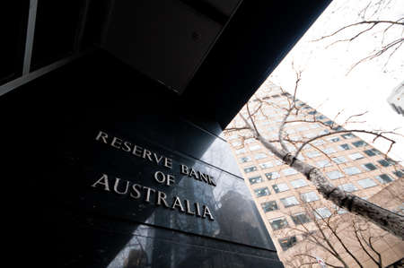 MELBOURNE, AUSTRALIA - JULY 26, 2018: Reserve Bank of Australia name on black granite wall in Melbourne Australia with a reflection of high-rise buildings. The RBA building is located at 60 Collins St, Melbourne VIC 3000 Australia. Editorial
