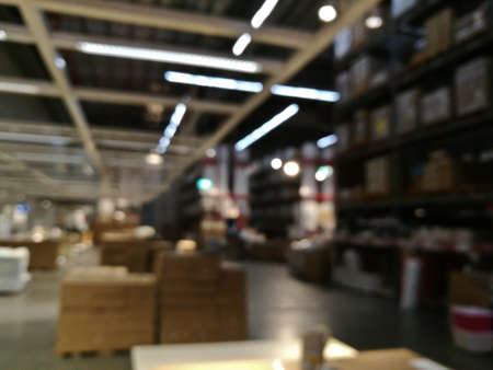 Defocused blurry scene of self service furniture warehouse shop