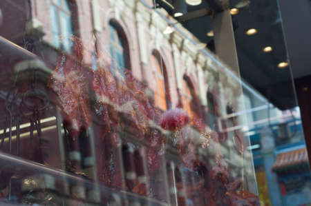 Roasted duck and BBQ pork hanged near Chinese restaurant window in Melbourne Australia 写真素材