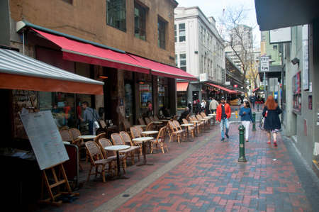 MELBOURNE, AUSTRALIA - JULY 30, 2018: Hardware lane with open restaurant and tourists walking aroudn in Melbourne Australia