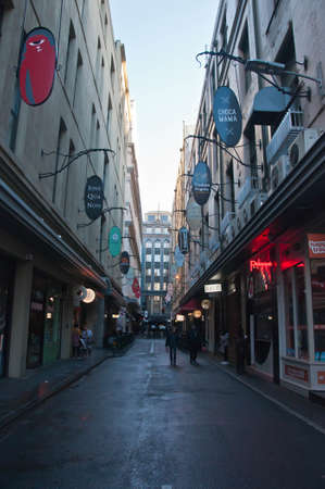 MELBOURNE, AUSTRALIA - JULY 29, 2018: Degrave laneway in Melbourne city center in the morning with tourists stand and walk along the street. The laneway is a famous landmark of Melbourne city.