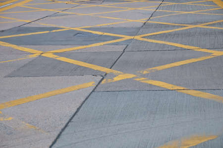 Abstract yellow painted traffic line pattern on concrete road street background