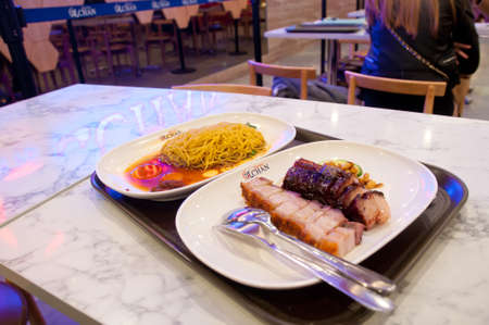 MELBOURNE, AUSTRALIA - JULY 26, 2018: BBQ and roast pork with golden egg noodle Hawker Chan Michelin stars restaurant in Melbourne Australia
