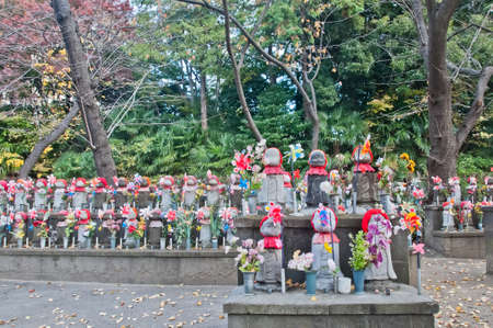 TOKYO, JAPAN - DECEMBER 1, 2018: Scene of wind turbine papers to worship souls of children in the back park of Zojo-ji Buddhist famous temple built from 1622. There is nobody in the photo. Editorial