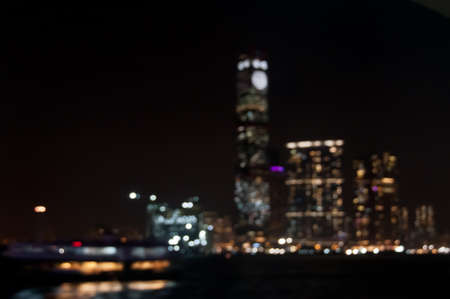 Defocused blurly night scene of high-rise office building corporate skyscrapers in Hong Kong Stock Photo