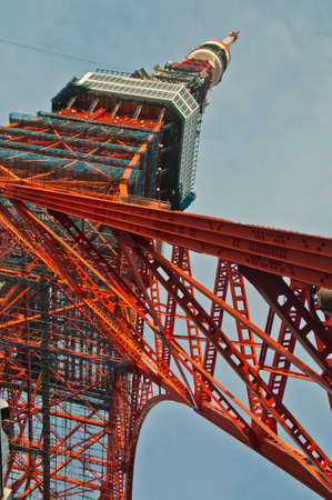 Famous Tokyo Tower situates in the central Tokyo in the morning. The tower is a communications and observation tower with around 330 metres tall and was built in 1958. There is nobody in the photo.