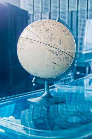 Vintage old classical retro Earth Globe model in a business strategy operation board executive management room 写真素材 - 150227568