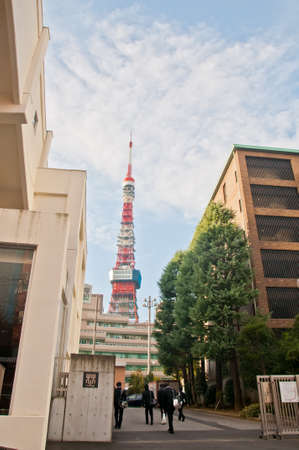 TOKYO, JAPAN - DECEMBER 1, 2018:  Main entrance gate of highschool near Tokyo Tower situates in the central Tokyo in the morning. The tower is a communications and observation tower with around 330 metres tall and was built in 1958. There are students wal