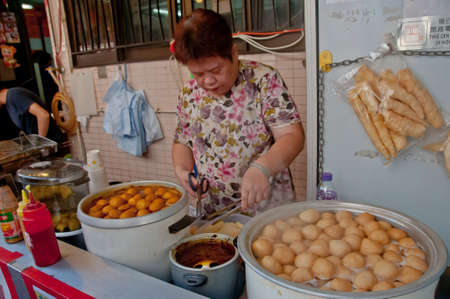 HONG KONG, HONG KONG SAR - NOVEMBER 18, 2018: Hong Kong spicy marinated XO sauce fish balls boil in large soup pot serving hot at street food stall by a local villager