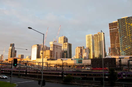 MELBOURNE, AUSTRALIA - JULY 26, 2018: Southern Cross train station and Melbourne Australia skyscrapers background