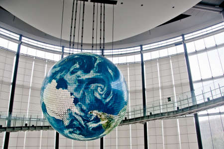 TOKYO, JAPAN - DECEMBER 2, 2018: Miraikan National Museum of Emerging Science and Innovation. The Geo-Cosmos floating earthsphere displays rendition of earth surface by 10 million pixels of organic LED panels. There is nobody in the photo.